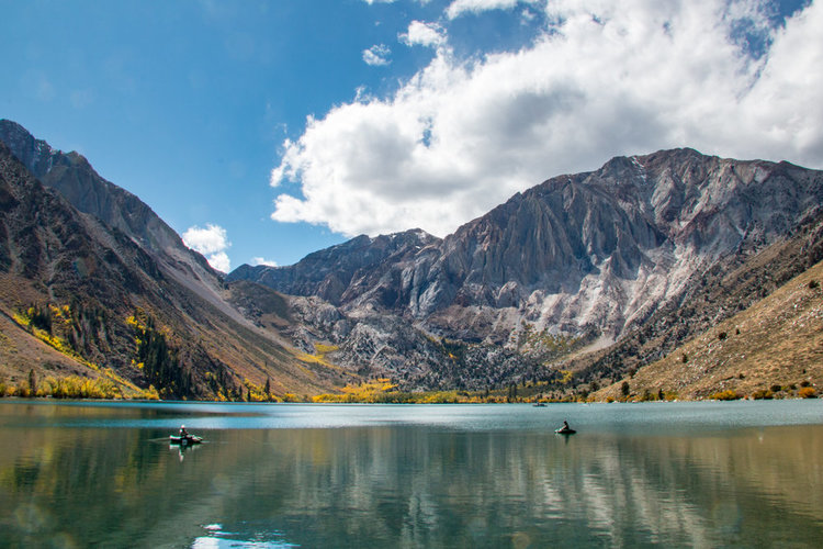 Convict Lake with fall colors and puffy clouds by Jeff Simpson
