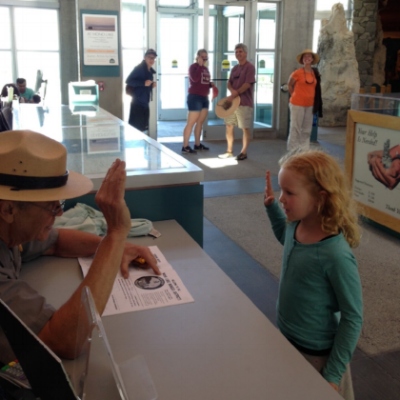 Little girl taking the junior ranger oath at the Mono Basin Scenic AreaVisitor Center